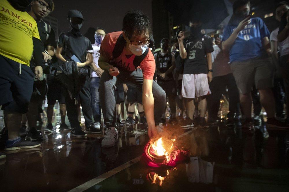 Hong Kong protestors burning LeBron's jersey