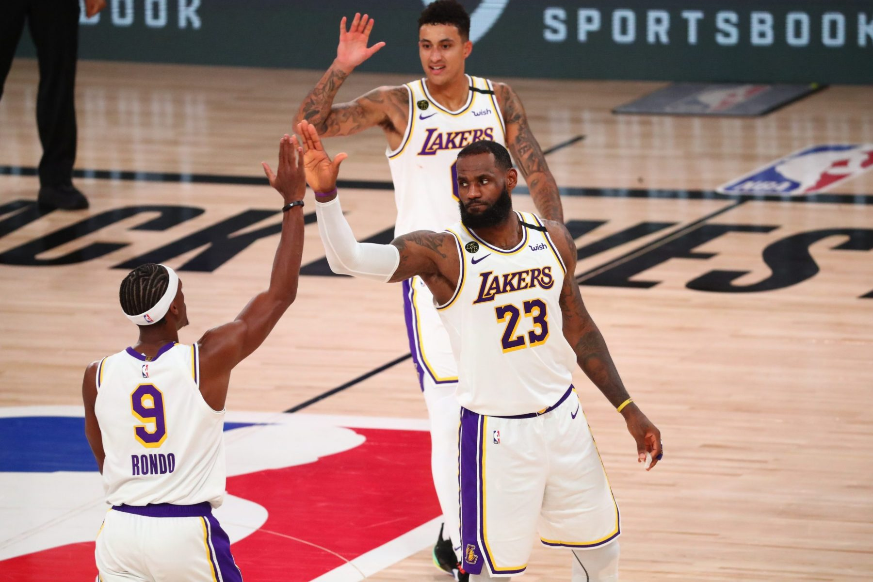 LeBron James, Rajon Rondo and Kyle Kuzma
