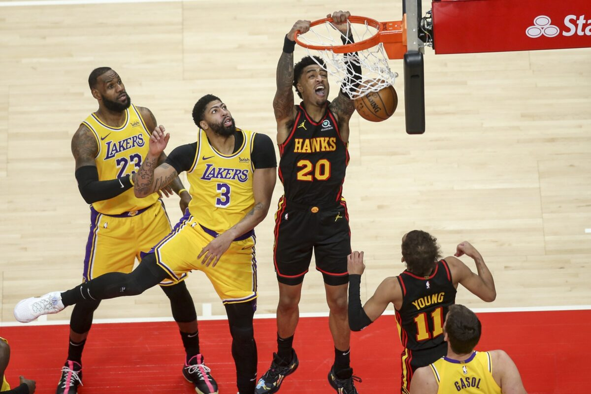 Hawks investigating courtside spat between Lakers' LeBron James, ejected fan